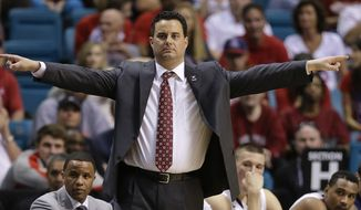 Arizona coach Sean Miller motions to players in the second half against Colorado during the second half of an NCAA college basketball game in the semifinals of the Pac-12 Conference on Friday, March 14, 2014, in Las Vegas. Arizona won 63-43. (AP Photo/Julie Jacobson)