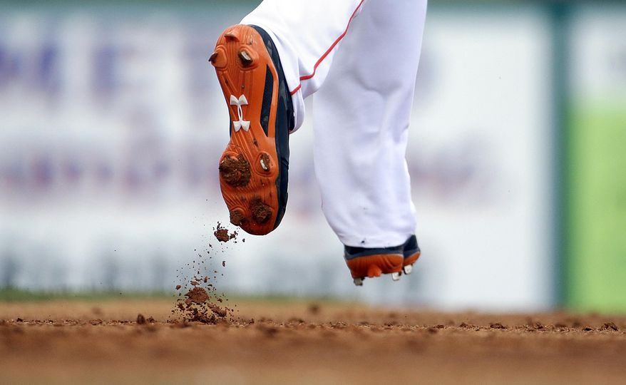 Dirt comes off the cleat of Miami Marlins' Marcell Ozuna as he leads off first base in the second inning of an exhibition spring training baseball game against the Washington Nationals, Saturday, March 15, 2014, in Jupiter, Fla. (AP Photo/David Goldman)