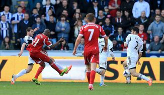 West Bromwich Albion's Youssouf Mulumbu, second left, shoots to score his team's second goal during their English Premier League soccer match against Swansea City at the Liberty Stadium, Swansea, Wales, Saturday, March 15, 2014. (AP Photo/Nick Potts, PA Wire)   UNITED KINGDOM OUT   -   NO SALES   -   NO ARCHIVES