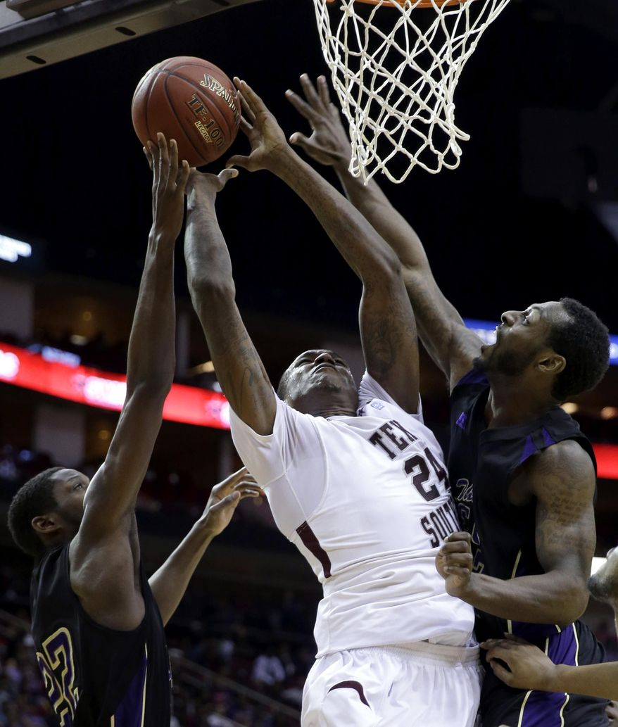 Texas Southern's Aaric Murray (24) goes up for a shot as Prairie View A&M's Rasi Jenkins (22) and Demondre Chapman, right, defend during the first half of an NCAA college basketball game in the championship of the Southwestern Athletic Conference tournament Saturday, March 15, 2014, in Houston. (AP Photo/David J. Phillip)