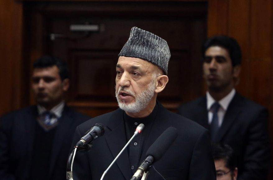 "Afghan President Hamid Karzai speaks during his final address to parliament during its opening session at the parliament house in Kabul, Afghanistan, Saturday, March 15, 2014. Karzai said the last 12 years of war were ""imposed"" on Afghans, a reference to the U.S.-led invasion that ousted the Taliban. (AP Photo/Rahmat Gul)"