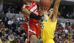 Ohio State center Trey McDonald (55) goes up for a shot against Michigan forward Jon Horford (15) in the first half of an NCAA college basketball game in the semifinals of the Big Ten Conference tournament Saturday, March 15, 2014, in Indianapolis. (AP Photo/Kiichiro Sato)