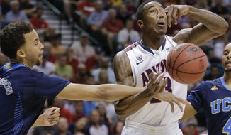 Arizona's Rondae Hollis-Jefferson, right,  is fouled by UCLA's Kyle Anderson in the first half during the championship game of the NCAA Pac-12 conference college basketball tournament, Saturday, March 15, 2014, in Las Vegas. (AP Photo/Julie Jacobson)