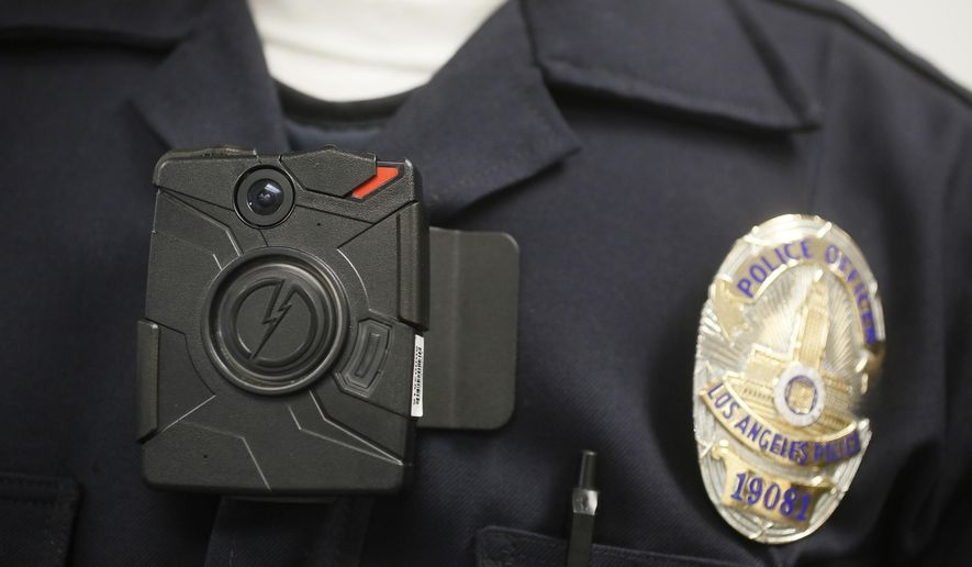 ** FILE ** This Jan. 15, 2014, file photo shows a Los Angeles Police officer wearing an on-body cameras during a demonstration for media in Los Angeles. (AP Photo/Damian Dovarganes)