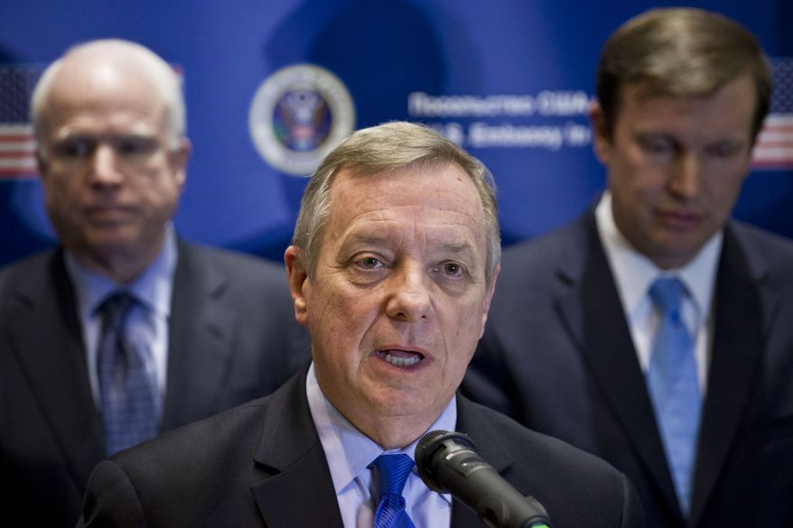 U.S. Sen. Dick Durbin, D-Ill., speaks during a news conference in Kiev, Ukraine, Saturday, March 15, 2014. Durbin and a team of seven other senators concluded their visit in Kiev on Saturday with a news conference in which they reaffirmed their support to the interim Ukrainian government. (AP Photo/David Azia)
