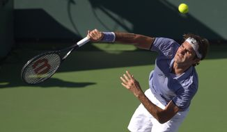 Roger Federer, of Switzerland, hits to Novak Djokovic, of Serbia, in the final match of the BNP Paribas Open tennis tournament, Sunday, March 16, 2014, in Indian Wells, Calif. (AP Photo/Mark J. Terrill)