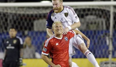 Real Salt Lake defender Nat Borchers clambers over San Jose Earthquakes forward Steven Lenhart for a head ball during the first of an MLS soccer match Saturday, March 15, 2014, in Santa Clara, Calif. (AP Photo/Marcio Jose Sanchez)
