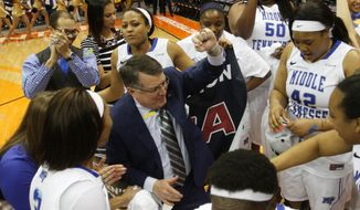 Middle Tennessee head coach Rick Insell dances with his players as they celebrate their their NCAA Conference USA tournament championship basketball game victory Saturday, March 15, 2014 in El Paso, Texas. (AP Photo/Victor Calzada)