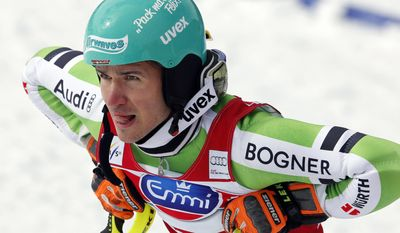 Germany's Felix Neureuther looks at the race results after completing an alpine ski World Cup slalom race, at the World Cup finals in Lenzerheide, Switzerland, Sunday, March 16, 2014. Marcel Hirscher beat Neureuther in a testy Austria vs. Germany duel for the World Cup slalom title on Sunday. (AP Photo/Marco Trovati)