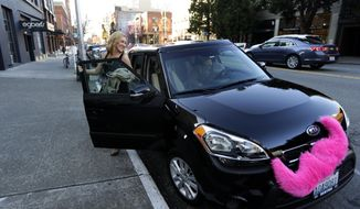 In this March 12, 2014 photo, Katie Baranyuk, gets out of a car driven by Dara Jenkins, a driver for the ride-sharing service Lyft, after getting a ride to downtown Seattle to meet friends after work. In a fight pitting upstart technology and traditional business, app-based ridesharing firms are fighting with taxi companies for supremacy in the Seattle market. (AP Photo/Ted S. Warren)