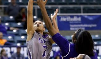 Stephen F. Austin's Kali Jerrell (3) shoots over Northwestern State's Kourtney Pennywell during the first half of an NCAA college basketball game in the championship of the Southland Conference tournament Sunday, March 16, 2014, in Katy, Texas. (AP Photo/David J. Phillip)