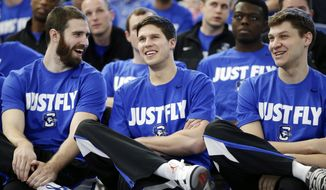 Creighton players, in the front row from left, Ethan Wragge, Doug McDermott and Grant Gibbs talk during a live broadcast of the Selection Sunday show in Omaha, Neb., Sunday, March 16, 2014. Creighton will play Louisiana-Lafayette in second round of the NCAA college basketball tournament in San Antonio. (AP Photo/Nati Harnik)