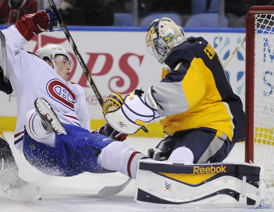 Montreal Canadiens right winger Brendan Gallagher, left, crashes into Buffalo Sabres goaltender Jhonas Enroth during the second period of an NHL hockey game in Buffalo, N.Y., Sunday, March 16, 2014. Enroth was injured and left the game. Montreal won 2-0. (AP Photo/Gary Wiepert)