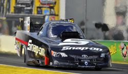 In this photo submitted by the NHRA, Cruz Pedregon races to the No. 1 qualifying position in Funny Car at the Amalie Motor Oil NHRA Gatornationals drag races, Saturday, March 15, 2014, in Gainesville, Fla. (AP Photo/NHRA, Teresa Long)