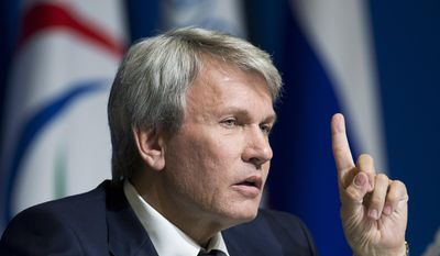 President of the the National Paralympic Committee of Ukraine Valeriy Suskevich holds up his finger during a press conference before the closing ceremony of the 2014 Winter Paralympics in Sochi, Russia, Sunday, March 16, 2014. (AP Photo/Pavel Golovkin)