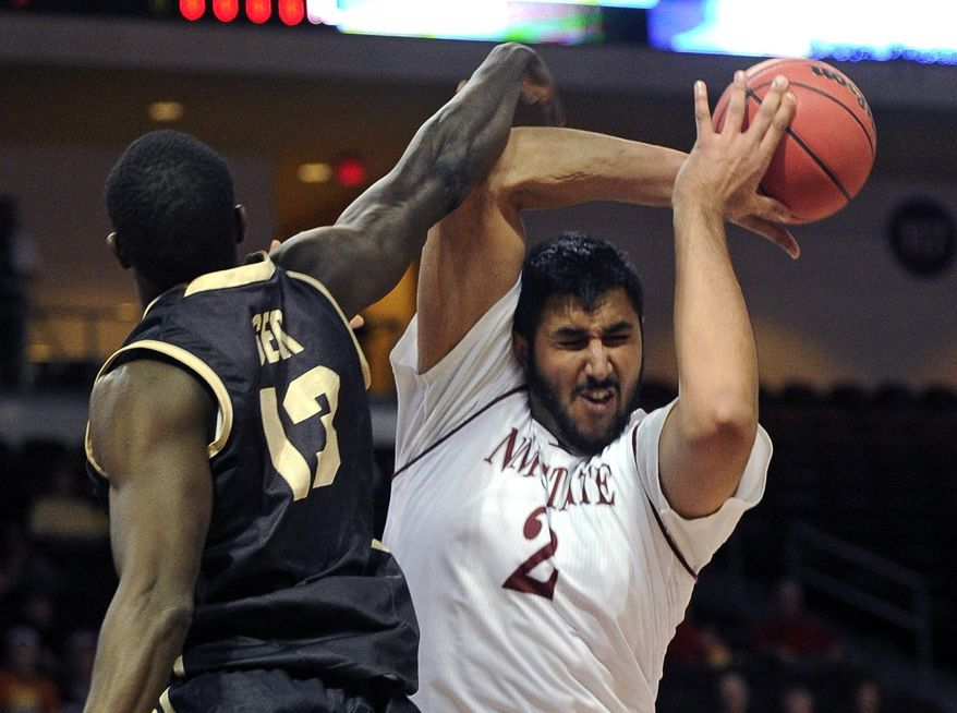 New Mexico State's Sim Bhullar (2) grabs a rebound against Idaho's Bira Seck during the first half of an NCAA college basketball game in the championship of the Western Athletic Conference men's tournament Saturday, March 15, 2014, in Las Vegas. (AP Photo/David Becker)