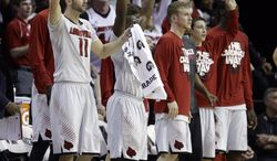 Louisville players watch during the second half of an NCAA college basketball game against Connecticut in the finals of the American Athletic Conference men's tournament Saturday, March 15, 2014, in Memphis, Tenn. Louisville won 71-61. (AP Photo/Mark Humphrey)