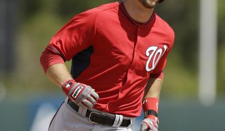 Washington Nationals shortstop Steven Souza rounds third base after his second home run of the game during the fourth inning of a spring exhibition baseball game against the Houston Astros in Kissimmee, Fla., Sunday, March 16, 2014. (AP Photo/Carlos Osorio)