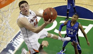 Virginia's Joe Harris (12) goes to the basket against Duke in the second half of an NCAA college basketball game in the championship of the Atlantic Coast Conference tournament in Greensboro, N.C., Sunday, March 16, 2014. Virginia won 72-63. Harris was the tournament MVP. (AP Photo/Bob Leverone)