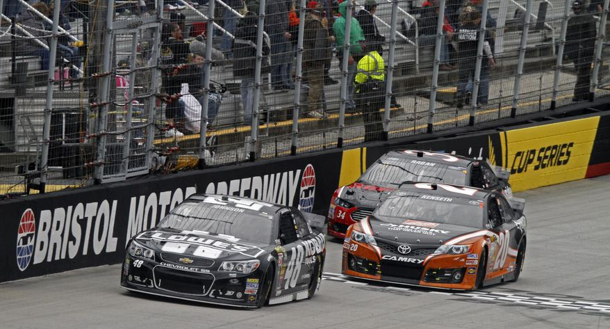Driver Jimmie Johnson (48) leads Matt Kenseth (20) and David Ragan (34) during the NASCAR Sprint Cup series auto race at Bristol Motor Speedway on Sunday, March 16, 2014, in Bristol, Tenn. (AP Photo/Wade Payne)