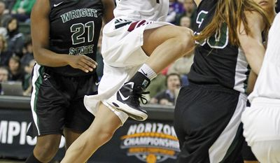 Green Bay guard Kaili Lukan drives the lane past Wright State forward Tayler Stanton (21) and guard KC Elkins (30) during the first half of an NCAA college basketball game for the Horizon League tournament championship on Sunday, March 16, 2014, in Green Bay, Wis. (AP Photo/Matt Ludtke)