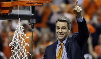 Virginia head coach Tony Bennett celebrates after defeating Duke in an NCAA college basketball game in the championship of the Atlantic Coast Conference tournament in Greensboro, N.C., Sunday, March 16, 2014. Virginia won 72-63. (AP Photo/Gerry Broome)
