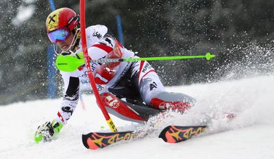 Austria's Marcel Hirscher speeds down the slope on his way to win the slalom title during an alpine ski World Cup slalom race, at the World Cup finals, in Lenzerheide, Switzerland, Sunday, March 16, 2014. (AP Photo/Shinichiro Tanaka)