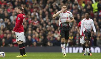 Liverpool's Steven Gerrard, centre right, celebrates after scoring against Manchester United during their English Premier League soccer match at Old Trafford Stadium, Manchester, England, Sunday March 16, 2014. (AP Photo/Jon Super)