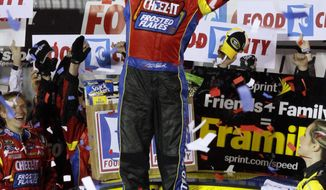 Driver Carl Edwards (99) celebrates in victory lane after winning the NASCAR Sprint Cup series auto race at Bristol Motor Speedway on Sunday, March 16, 2014, in Bristol, Tenn. (AP Photo/Wade Payne)