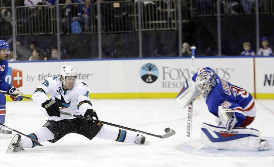 San Jose Sharks' Logan Couture (39) shoots the puck past New York Rangers goalie Henrik Lundqvist (30), of Sweden, during the first period of an NHL hockey game on Sunday, March 16, 2014, in New York. (AP Photo/Frank Franklin II)