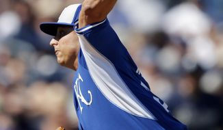 Kansas City Royals starting pitcher Jason Vargas throws during the fourth inning of a spring exhibition baseball game against the San Diego Padres, Sunday, March 16, 2014, in Peoria, Ariz. (AP Photo/Darron Cummings)
