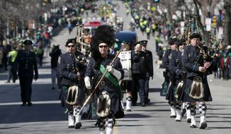 The Boston Police Gaelic Column marches in the annual St. Patrick's Day parade in the South Boston neighborhood of Boston, Sunday, March 16, 2014. (AP Photo/Michael Dwyer) ** FILE **
