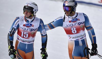 Norway's Henrik Kristoffersen, left, and teammate Aksel Lund Svindal, right, stand in the finish area after the first run of the men's giant slalom race at the alpine skiing World Cup finals in Lenzerheide, Switzerland, Saturday, March 15, 2014. Svindal did not complete his race. (AP Photo/Keystone, Peter Schneider)