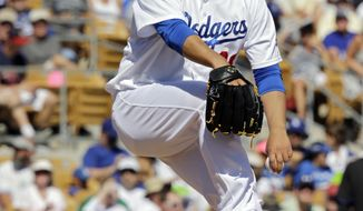 Los Angeles Dodgers starting pitcher Hyun-Jin Ryu delivers against the Colorado Rockies in the fifth inning of a spring exhibition baseball game on Sunday, March 16, 2014, in Glendale, Ariz. (AP Photo/Mark Duncan)