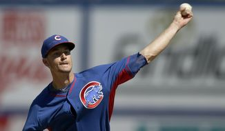 Chicago Cubs starting pitcher Chris Rusin delivers a pitch during the first inning of a spring exhibition baseball game against the New York Mets Sunday, March 16, 2014, in Las Vegas. (AP Photo/Isaac Brekken)