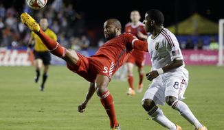 San Jose Earthquakes defender Victor Bernardez, left, clears the ball next to Real Salt Lake forward Joao Plata during the first half of an MLS soccer match Saturday, March 15, 2014, in Santa Clara, Calif. (AP Photo/Marcio Jose Sanchez)