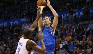 Dallas Mavericks forward Dirk Nowitzki (41) shoots over Oklahoma City Thunder forward Serge Ibaka (9) in the first quarter of an NBA basketball game in Oklahoma City, Sunday, March 16, 2014. (AP Photo/Sue Ogrocki)