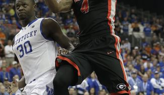 Georgia guard Charles Mann (4) shoots over Kentucky forward Julius Randle (30) during the second half of an NCAA college basketball game in the semifinal round of the Southeastern Conference men's tournament, Saturday, March 15, 2014, in Atlanta. (AP Photo/Steve Helber)