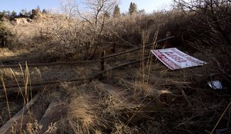 The Waldo Canyon trailhead near Colorado Springs, Colo., remains closed Thursday, March 13, 2014, nearly two years since the Waldo Canyon Fire closed the popular trail for hikers, runners and mountain bikers. (AP Photo/The Gazette, Christian Murdock)