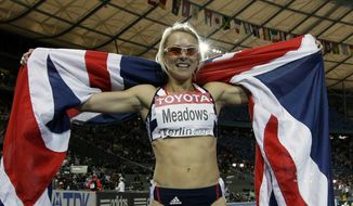 FILE - This is a  Wednesday, Aug. 19, 2009 file photo of Britain's Jenny Meadows as she celebrates after winning the bronze medal in the final of the Women's 800m during the World Athletics Championships in Berlin. British runner Jenny Meadows is using a revolutionary DNA test designed to prevent injury and improve her performance ahead of the Commonwealth Games _ and a trio of leading European football teams are about to follow her lead. The test is a brainchild of London-based company DNAFit, which obtains genetic profiles _ using a simple mouth swab _ to identify genes that make athletes prone to certain injuries. It can also ensure they can tailor a program of training and nutrition to fit their DNA. (AP Photo/David J. Phillip, File)