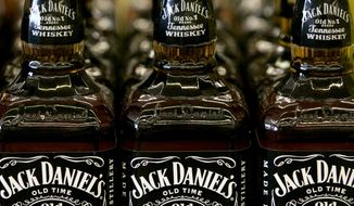 In this May 24, 2005 photo, Bottles of Jack Daniel's Tennessee Whiskey are on display at a Kansas City, Mo. liquor.  If it isn't fermented in Tennessee from mash of at least 51 percent corn, aged in new charred oak barrels, filtered through maple charcoal and bottled at a minimum of 80 proof, it isn't Tennessee whiskey. So says a year-old law here that resembles almost to the letter the process used to make Jack Daniel's. Now lawmakers are looking at amending that law so that some of the craft distillers that have sprung up in recent years can label their products Tennessee whiskey, a distinctive and popular draw in the booming American liquor business. The people behind Jack Daniel's see the hand of a bigger rival at work, however, the foreign-owned conglomerate that makes George Dickel, another famed Tennessee brand.  (AP Photo/Charlie Riedel)