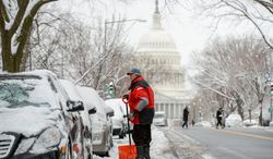 Steve Kreiss of Washington, D.C. shovels out his car Monday on East Capitol Street in Capitol Hill after another snowstorm hit the nation's capitol. (andrew harnik/the washington times)