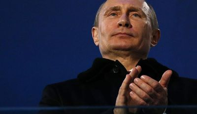 Russian President Vladimir Putin attends the closing ceremony of the 2014 Winter Paralympics at the Fisht Olympic stadium in Sochi, Russia, Sunday, March 16, 2014.  (AP Photo/Dmitry Lovetsky)