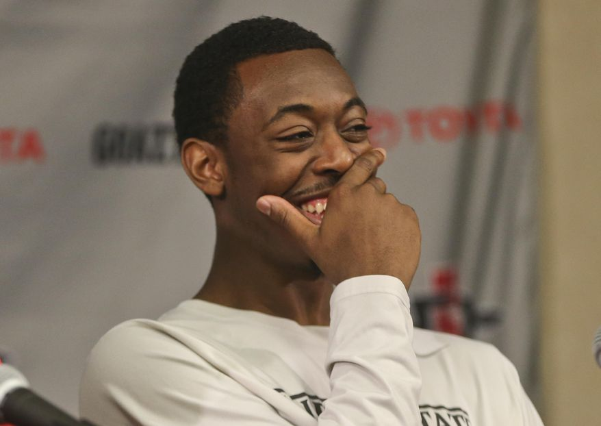"San Diego State guard Xavier Thames, the Mountain West Player-of-the-Year, can't stop laughing as teammates try to answer a question  regarding New Mexico State's 7'5"", 360 pound center Sim Bhullar who San Diego State will face in the team's first round NCAA basketball tournament game against New Mexico State at a press conference Monday, March 17, 2014, in San Diego.  (AP Photo/Lenny Ignelzi)"