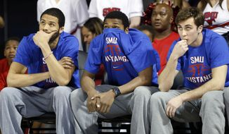 Southern Methodist Mustangs center Cannen Cunningham, left, Southern Methodist Mustangs guard Sterling Brown, center, and Southern Methodist Mustangs guard Jonathan Wilfong (20) sit dejected after their name was not called to play in the NCAA Tournament during the SMU NCAA Tournament watching party in Moody Coliseum at Southern Methodist University in Dallas, on Sunday, March 16, 2014.    (AP Photo/The Dallas Morning News, Vernon Bryant)  MANDATORY CREDIT; MAGS OUT; TV OUT; INTERNET USE BY AP MEMBERS ONLY; NO SALES