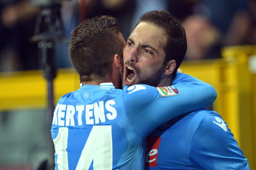 Napoli forward Gonzalo Higuain, right, celebrates with his teammate Dries Mertens after scoring during a Serie A soccer match between Napoli and Torino, at the Olympic  stadium, in Turin, Italy, Monday, March 17, 2014. (AP Photo/Massimo Pinca)
