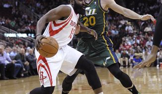 Houston Rockets's James Harden (13) tries to get past Utah Jazz's Gordon Hayward (20) in the first half of an NBA basketball game Monday, March 17, 2014, in Houston. (AP Photo/Pat Sullivan)