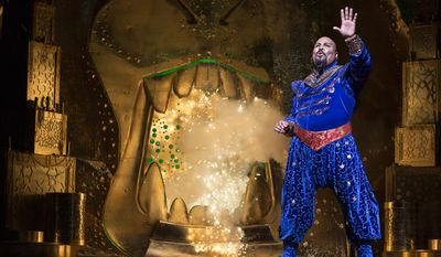 "This undated image released by Disney Theatrical Productions shows James Monroe Iglehart as the Genie during a production of the musical ""Aladdin."" As the fast-talking Genie in Disney Theatrical Group's latest Broadway extravaganza, Iglehart is taking a different tact than his hero Robin Williams did in the 1992 animated ""Aladdin."" Iglehart is channeling some smooth cool from bandleader Cab Calloway and ragtime entertainer Fats Waller. The creative team has urged him to make the role his own, and he has, adding things like a series of friendly fist-bumps between him and Aladdin. He's also learned to tap dance. (AP Photo/Disney Theatrical Productions, Cylla von Tiedemann)"