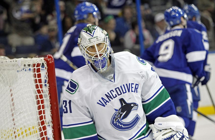Vancouver Canucks goalie Eddie Lack, of Sweden, reacts after allowing a goal by Tampa Bay Lightning left wing Ondrej Palat during the second period of an NHL hockey game Monday, March 17, 2014, in Tampa, Fla. (AP Photo/Brian Blanco)