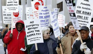 FILE - In this Oct. 23, 2013 file photo protesters rally outside federal court during Detroit's bankruptcy proceedings. Winners and losers will emerge in the largest municipal bankruptcy in U.S. history, and nowhere is that more evident than the differences proposed for the two classes of retirees in the plan filed last month by state-appointed emergency manager Kevyn Orr. (AP Photo/Paul Sancya, File)